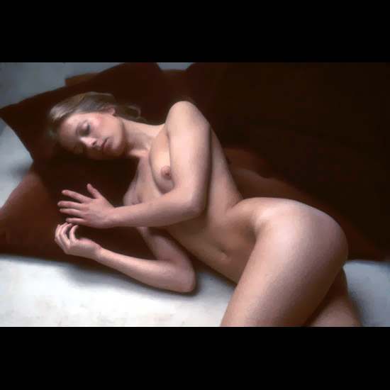 Hot nude art model laying naked on the sofa captured by photo camera