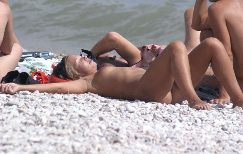 Sleeping blond beauty tanning at the sun with her warm treasure up
