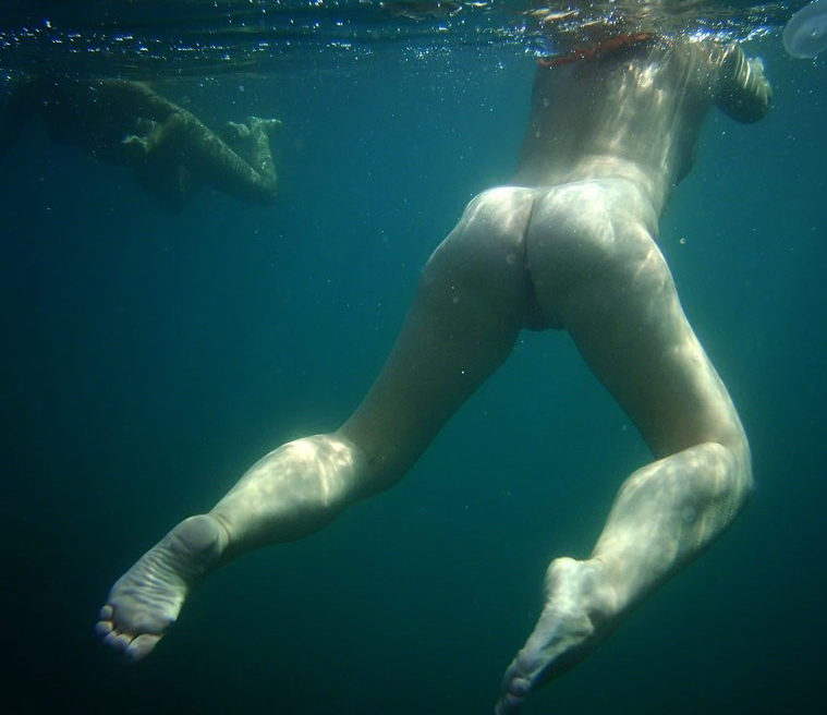 Underwater nude photo reveal hot butt and tasty camel toe pussy