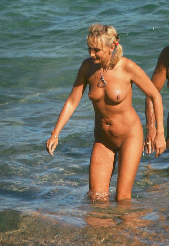 Blond chubby mature lass with pierced belly and priceless naked body getting out from water