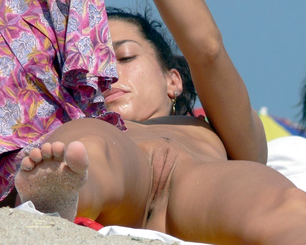 Tanned babe with brown skin spied at the beach with her amazing clean pussy exposed