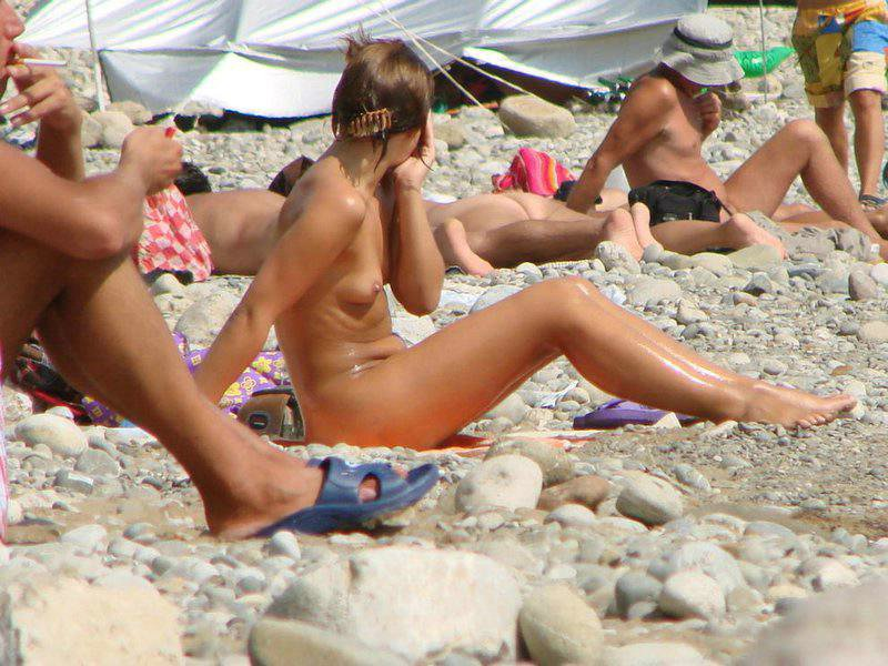 Nudist chick with firm diddies and hard nipples