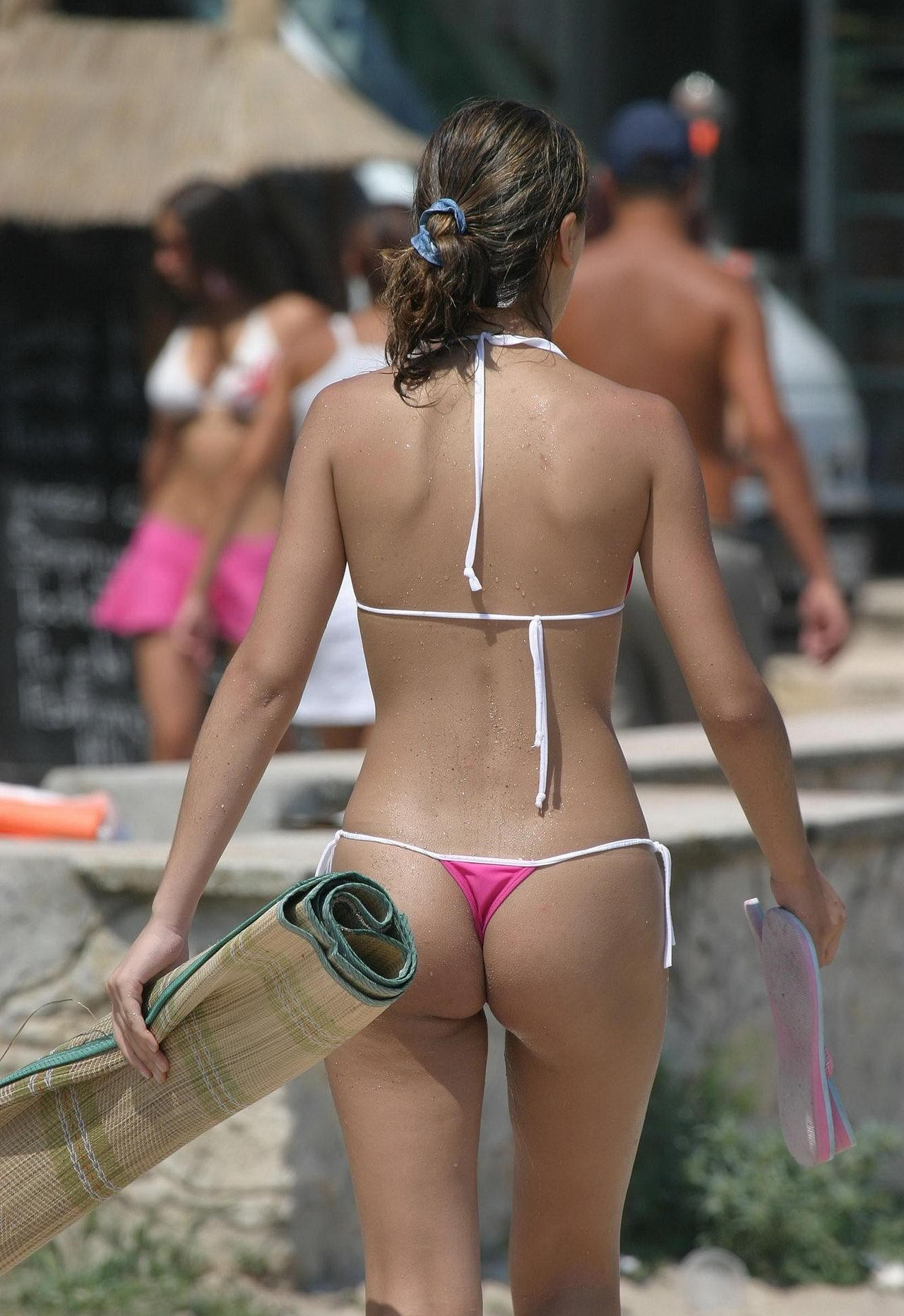 Bikini clad babe constantly looking for the right sunbathing spot