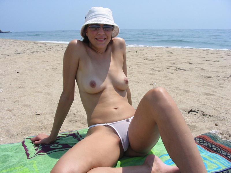 Semi naked model chilling on the shore