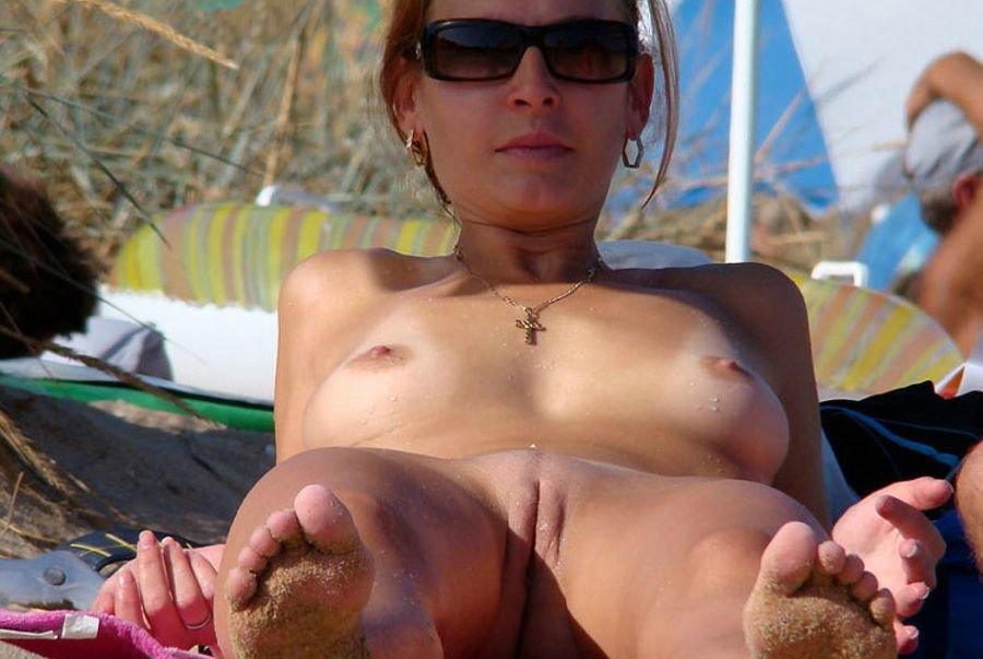 Sensual milf does not mind parading her privates in public