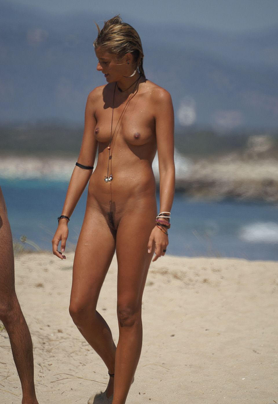Sun tanned sultry mistress checking out someones ass