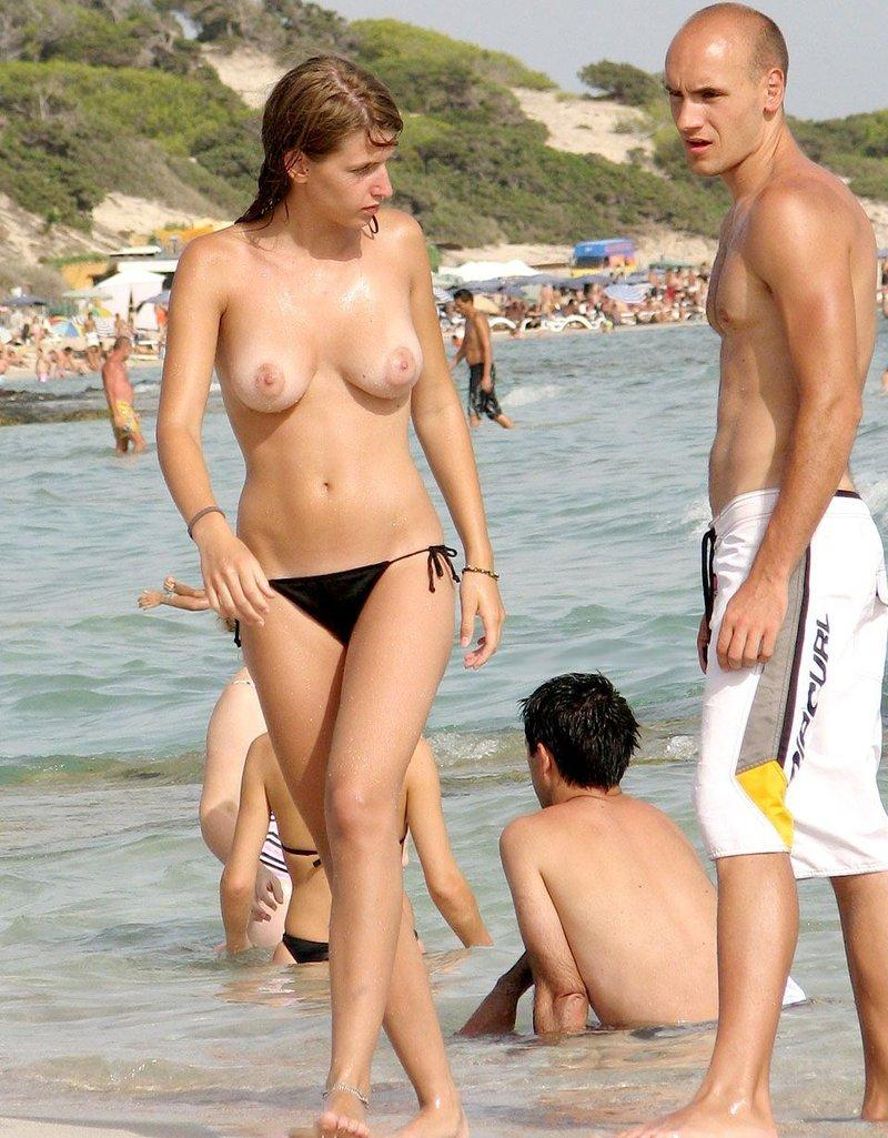 Naughty topless damsel gets attention from a horny guy