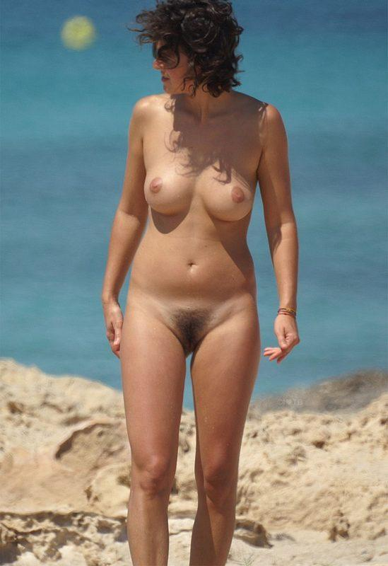 Slut showing her hairy muff on the beach
