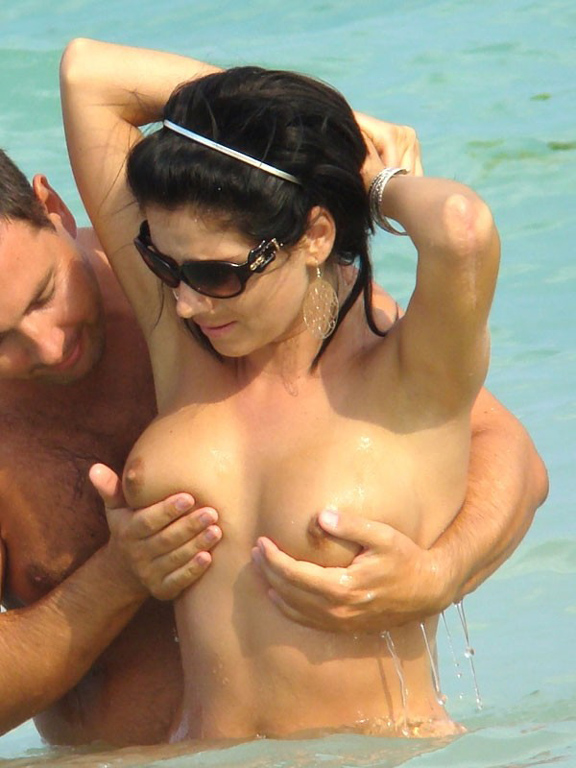 Some lucky guy helps this beauty to get her tits wet in the water