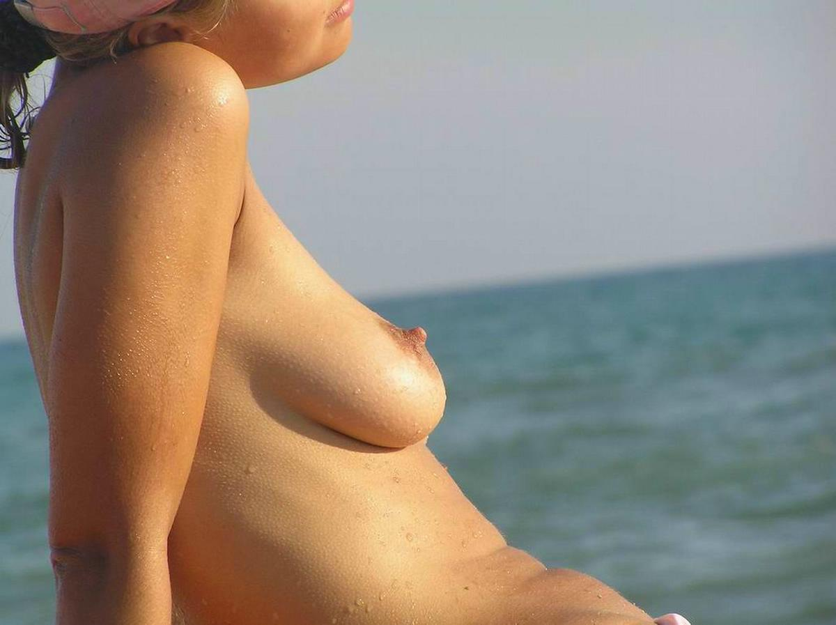 Sunbathing girl expose her perky nipple