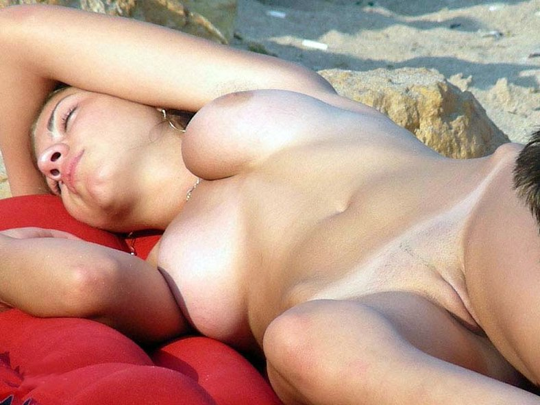 Shaved beauty sleeping on a red towel